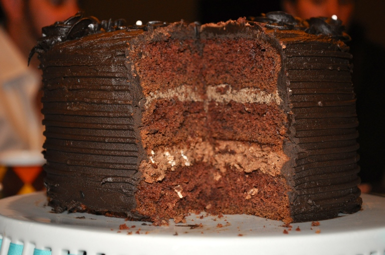 The final product: Cake, chocolate cheesecake, cake, mocha-chocolate cream, cake, and CHOCOLATE FROSTING. ...deep breath!